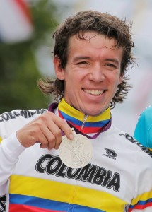Rigoberto Uran of Colombia celebrates after winning the silver medal in the Men's Road Cycling race at the 2012 Summer Olympics, Saturday, July 28, 2012, in London. Alexander Vinokourov of Kazakhstan won the gold medal, with Alexander Kristoff of Norway claiming bronze. (AP Photo/Christophe Ena)