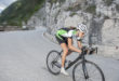 girl by downhill with road cycle - blurred motion